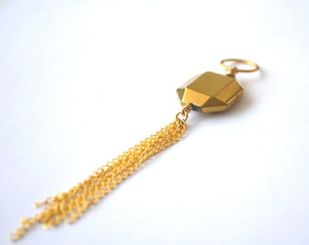 gold tone ornament with chain fringe