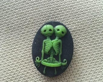 Green on Black Conjoined Skeleton Twins Needle Minder