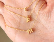 Tiny gold cursive  initial necklace, tiny letter necklace, dainty lowercase initial letter necklace, delicate necklace, bridesmaid gift