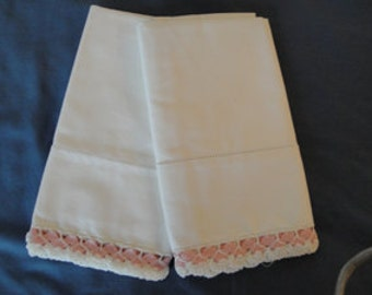 Unused Ribbon and crochet lace edged pillowcases