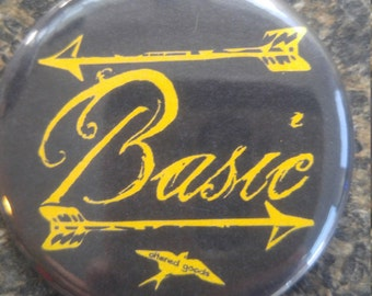 Basic arrow button or bottle opener