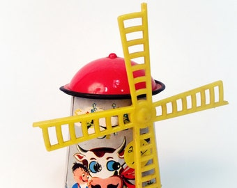 Lovely windmill toys in white iron  and hand-painted.From the 50's and made in japan.