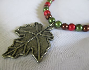 Red, Green, and Brown Pearl Necklace with Fall Leaf
