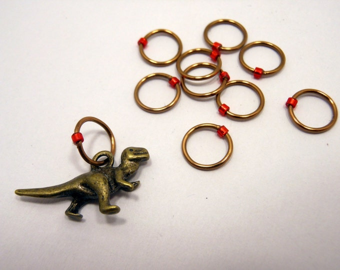 Featured listing image: Snagless Stitch Markers ~ Rawr! ~ Set of 10 ~ Bronze T-Rex Dinosaurs with Red Markers