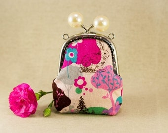 Pearl kiss lock coin purse.   Woodland theme fabric with a rabbit, trees, flowers and a butterfly.