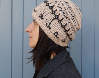 Hat knitted and embroidered. Diego