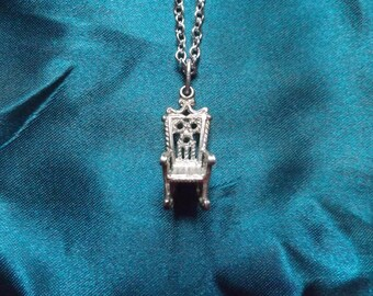 Vintage rocking chair necklace.