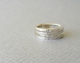 Stackable Rings. Sterling Silver stacking ring set of 4. Side of Coin texture. Ring stack
