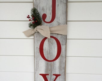 Rustic JOY wood sign.  Hand painted and stained with lettering done in christmas red!  It comes with a tie and a sprig of greenery.
