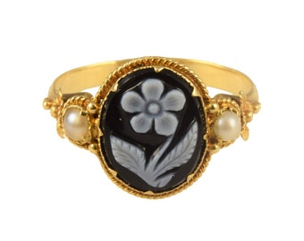 Victorian onyx cameo and pearl ring with floral detail, circa 1860.