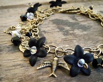 OOAK // Charm Bracelet // Antique Gold // Swarovski Crystal // Jet Black & Crystal AB Beads // Black Lucite Flowers // Gold Charms