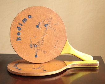 Two vintage wood kadima paddles with yellow handles