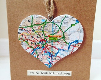 Valentines card with wooden heart covered in map