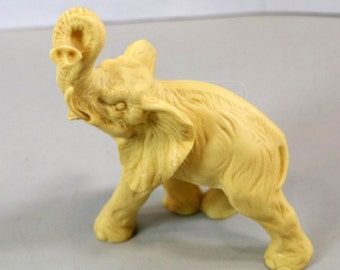 Vintage (1970's) Hand Carved Ivory Colored Resin African Elephant Statue