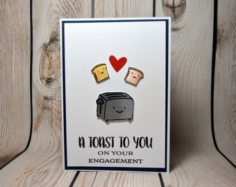 Engagement card with cute toast to announce it