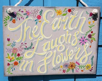 Hand Painted wooden sign  - The earth laughs in flowers