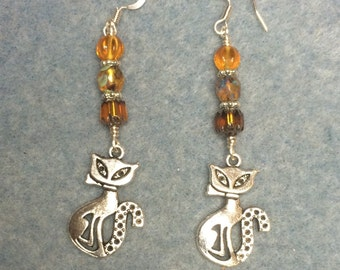 Silver cat charm dangle earrings adorned with topaz Czech glass beads.