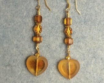 Amber Czech glass heart earrings adorned with amber Czech glass beads.