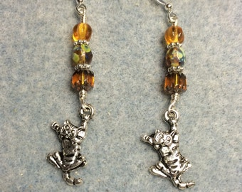 Silver tabby cat charm earrings adorned with amber Czech glass beads.
