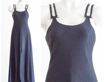 1970s black sleeveless maxi dress with tall front slit