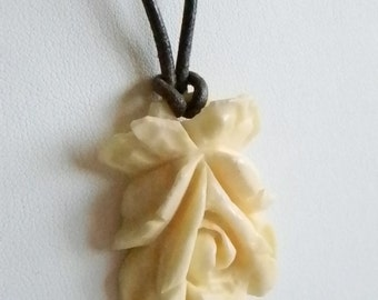 Faux Ivory Rose Bud Pendant with Brown Leather Like Rope Necklace
