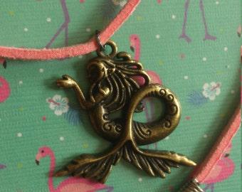 Bronze mermaid pendant on pink suede cord