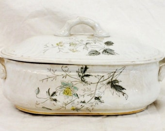 Antique covered vegetable dish. Marked