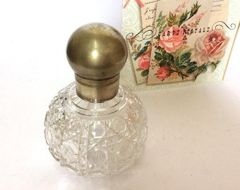 Antique Heavy Glass Globe Shaped Perfume Bottle,Silverplated top & original glass stopper.c1920.starburst base.