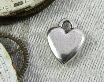 Set of (12) Silver 3D Heart Charms larger 12 per package  LOV007