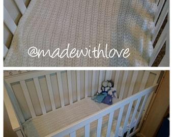 soft cream hand knitted baby blanket