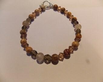 Beaded hand made bracelet w/ Rutilated Quartz