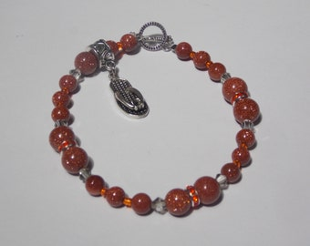 Hand made one of a kind  Beaded bracelet w/ silver charm Flip flop