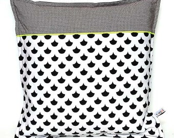 Graphic black and white and fluorescent yellow cushion