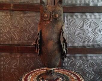 Primitive standing owl