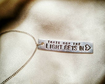 That's how the light gets in - stamped pewter charm necklace