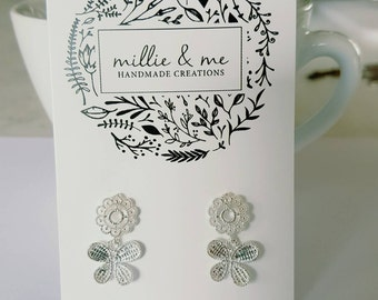 Silver lace butterfly drop earrings.