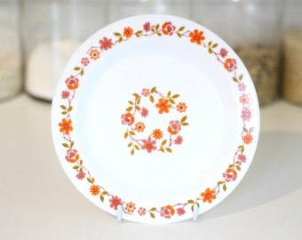 Five pretty floral Arcopal side plates