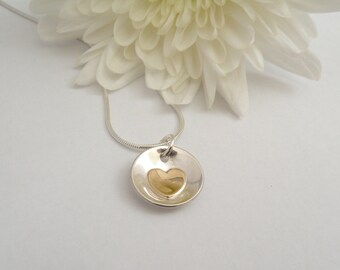 Sterling silver and 9ct gold heart necklace