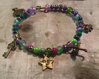 Funky purple and green charm bracelet