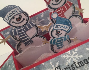 Pop up christmas card with snow men