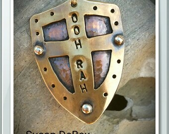 """Copper Sterling Silver and Brass Shield that is stamped to say, """"OOH RAH"""" with a 24"""" ball chain"""