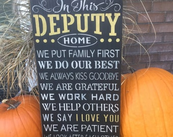 In This Deputy Home, wood sign