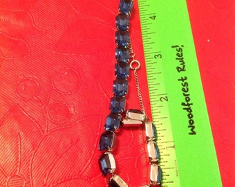Silver tone braclet with blue stones