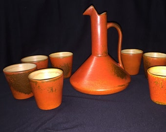 Mid Century atomic orange ceramic pitcher and tumblers