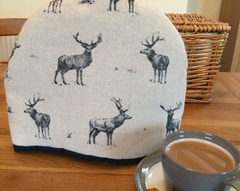 Tea cosy, Tea cozy made with a linen mix print of navy Stags on a natural base. Perfect for four to six cups