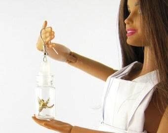 earrings glass bottle with origami bird inside