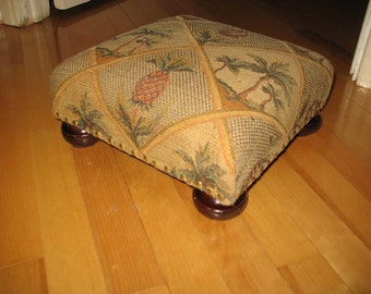 Pouf is extra fabric and wooden base or foot. Furniture, Chair, Ottoman, living room.