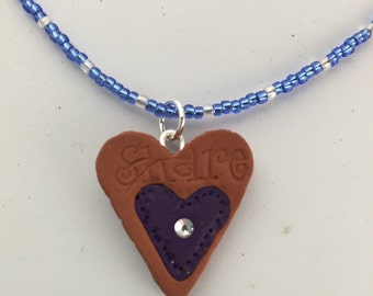 N-004  Heart infusible penent on a lavender LT  beaded necklace