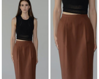 Designer Christian Dior, high waisted, wool skirt, size 6.