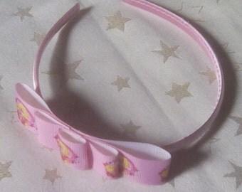 Pink satin headband with princess Aurora
